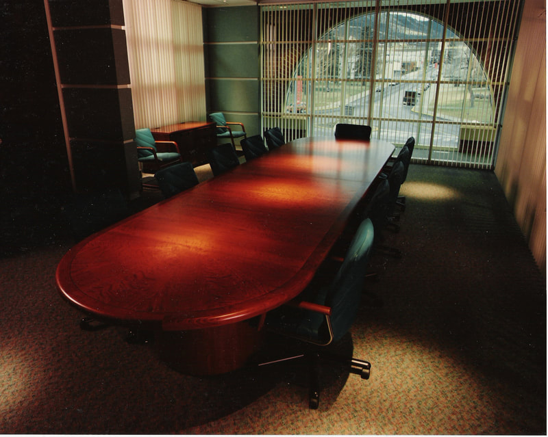 Custom office furniture, conference tables, reception areas