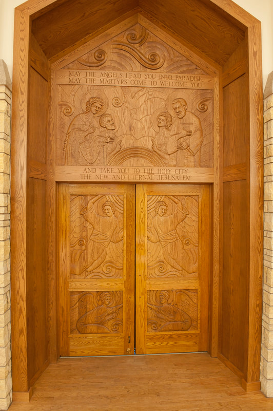 Hand-carved entry doors